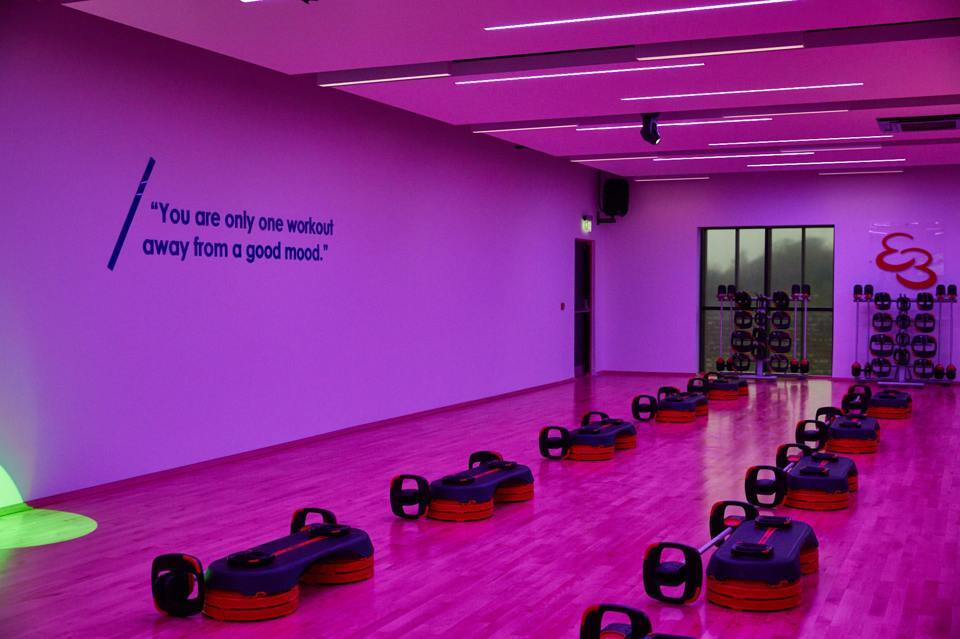 Alderley park gym studio with weights and a purple ambient lighting