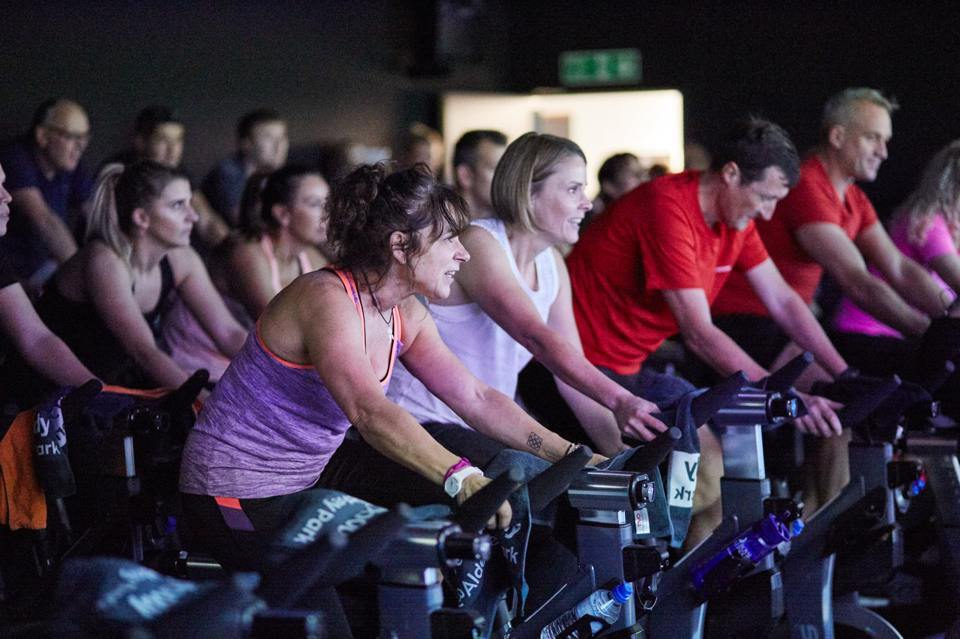 Crowd of people participating in a spin class