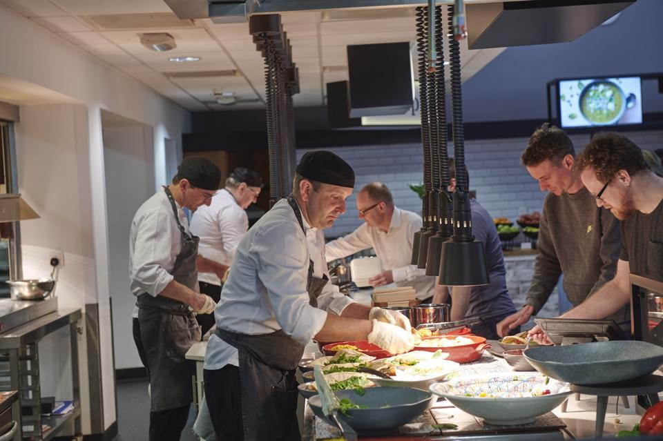 Chefs cooking food at mereview restaurant