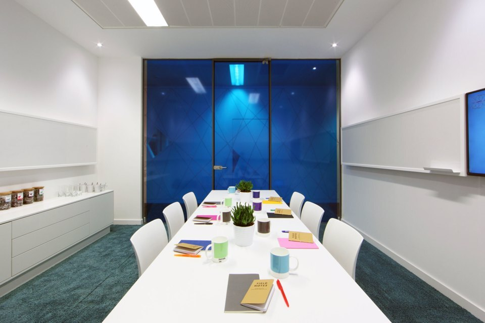 A 6 person meeting room with a blue glass window at Citylabs 1.0
