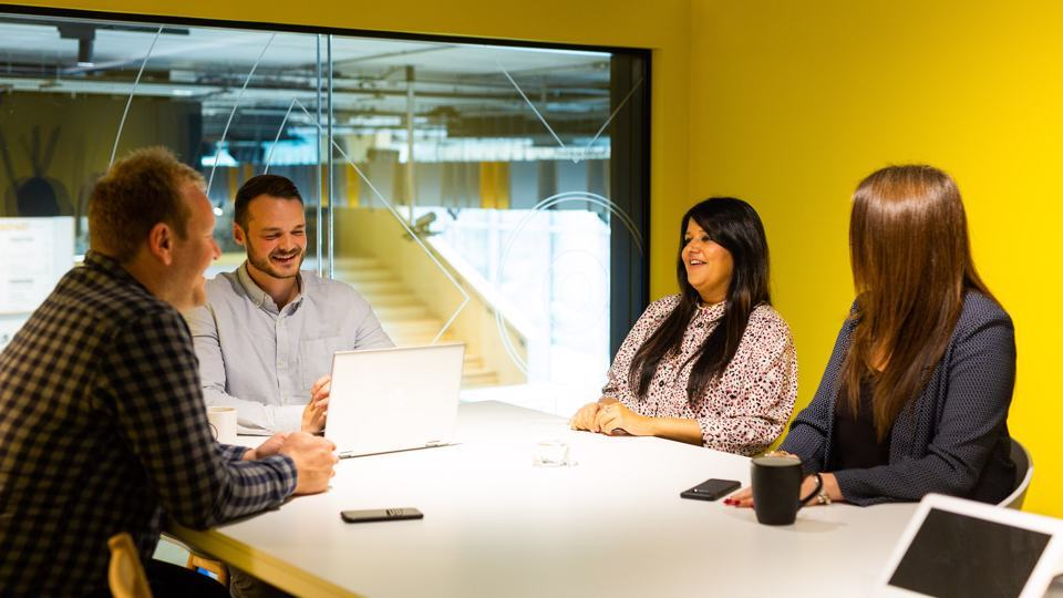 Group of people sat in a meeting room