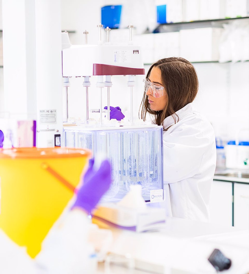 A woman working in a lab at Alderley Park