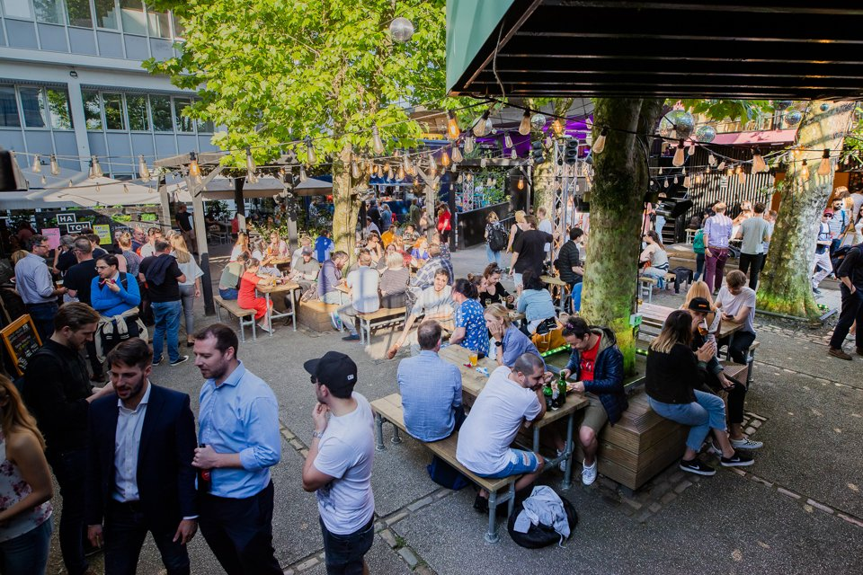 Customers sat in the garden of Manchester Hatch food destination