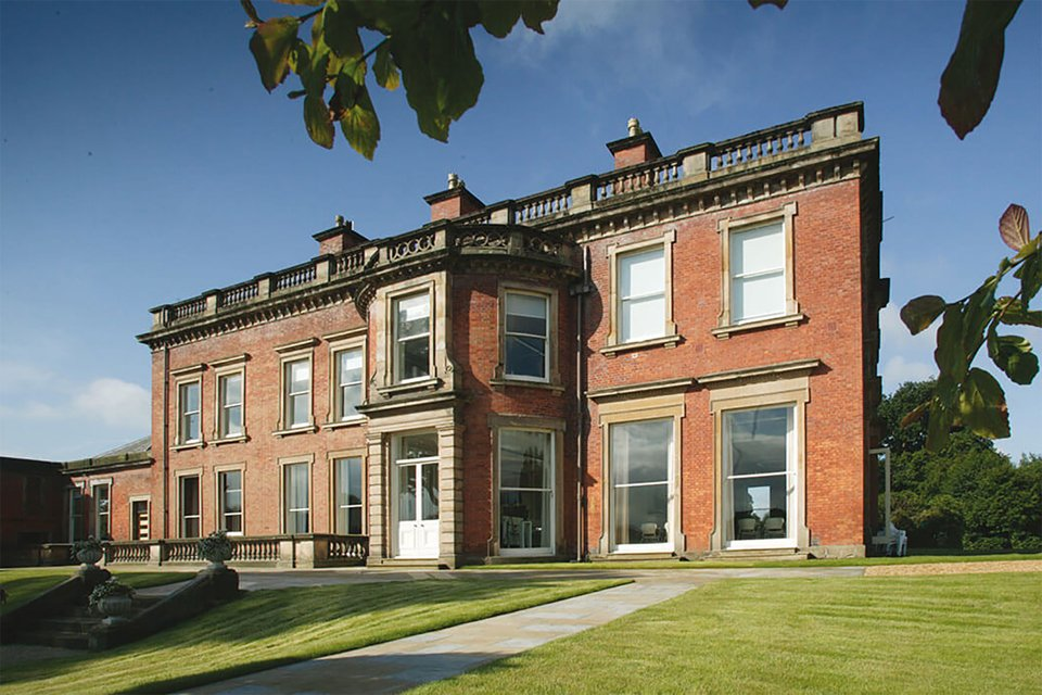 Outside look at the front of the booths park building surrounded by tress and grass