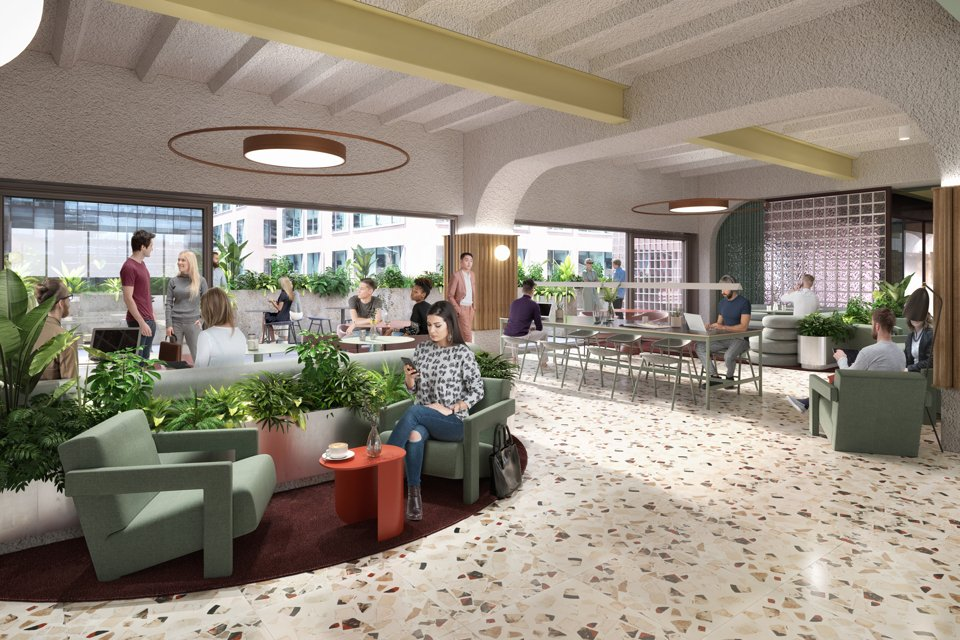 Inside look at a large social and work area inside the plaza building with people sat drinking coffee, working and collborating