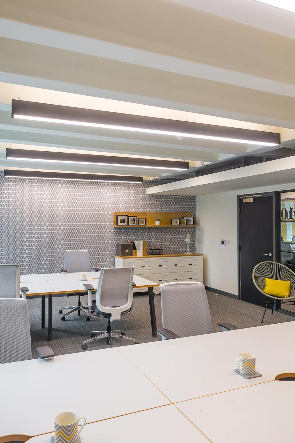 Bruntwood office space containing large white desks and white office chairs at 111 piccadilly
